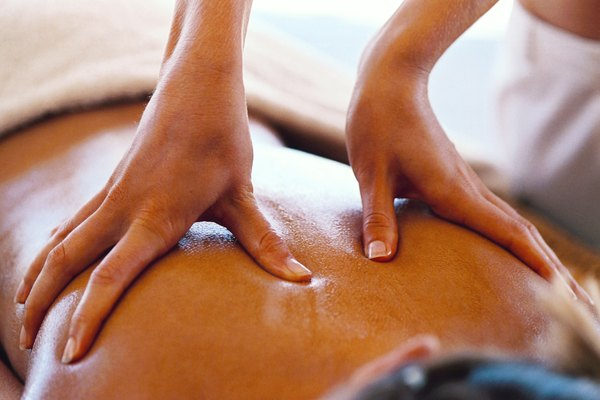 close-up of a young woman getting a back massage