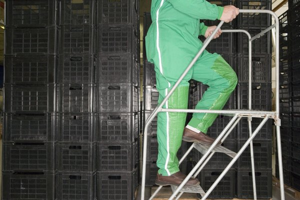 Factory worker climbing steps