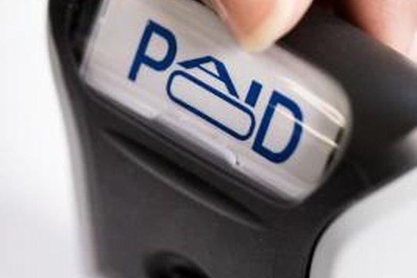 """Las ordenes de trabajo se etiquetan como """"completadas"""" y las facturas como """"pagadas""""."""