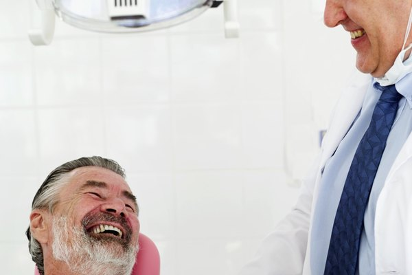 dentist and a mature man smiling