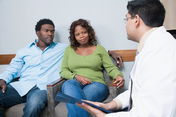 Patient and spouse consulting with doctor