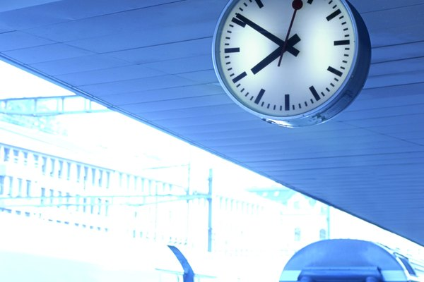 Blue tone of trains entering the train station with the clock above in St. Gallen, Switzerland.