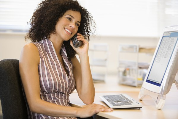 Businesswoman talking on phone at desk