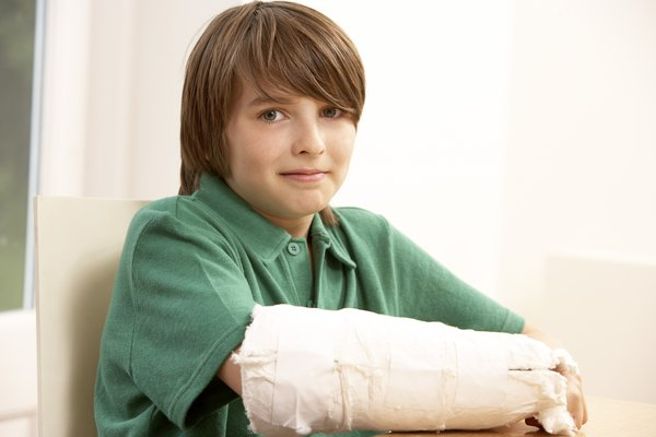 Boy with broken arm in cast