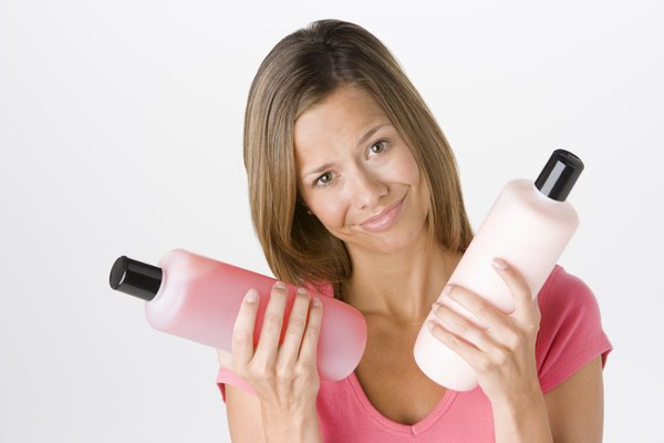 Woman with shampoo and conditioner