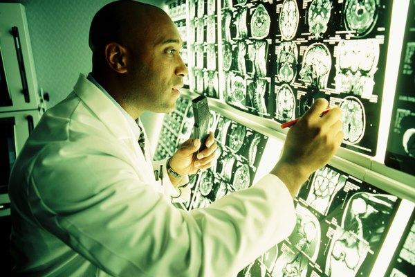 Doctor looking at MRI monitoring screen