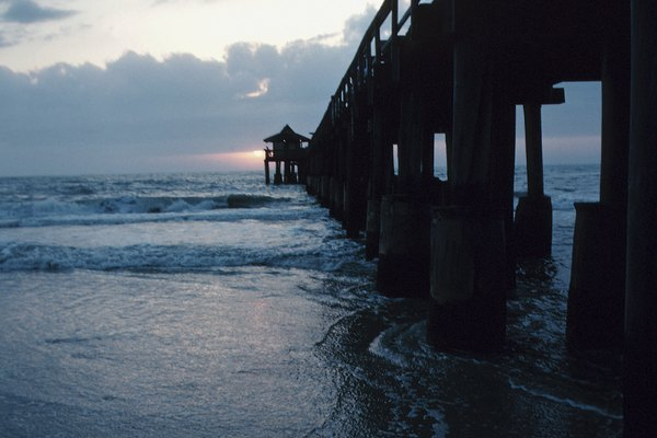View of a wooden pier and ocean , Naples beach , Florida , America