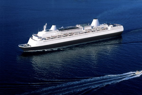 Aerial of a cruise ship on the ocean.