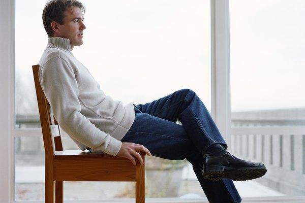 Side View of Man Sitting Near Window