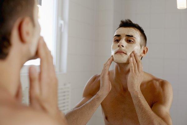 Man applying face mask