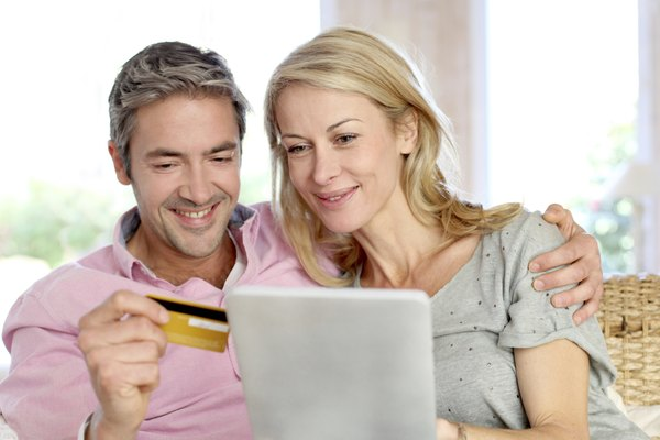 Couple doing shopping online from home