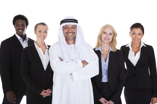 Arabic Man Standing With Businesspeople