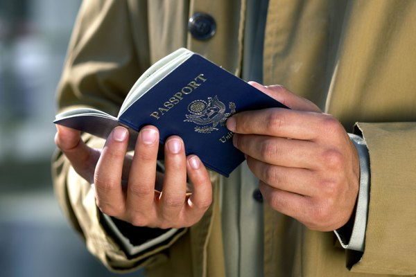 Traveler holding American passport