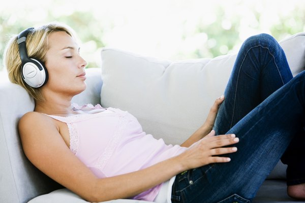 Woman listening to music and resting