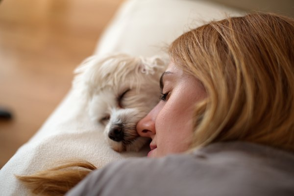 Woman and dog sleeping together