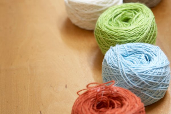 Use balls of yarn to play an indoor group game.