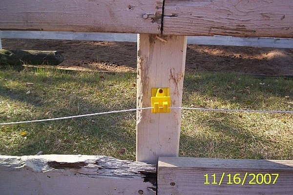 Nail An Insulator On Each Wooden Post It Is Helpful To Position Them In Between The Rails See Picture