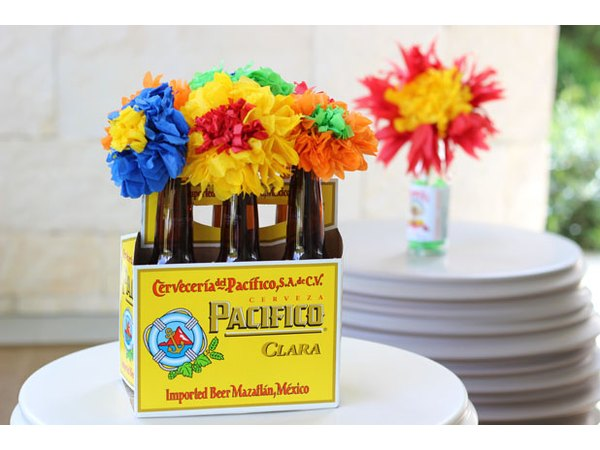 Arrange flowers in beer bottles