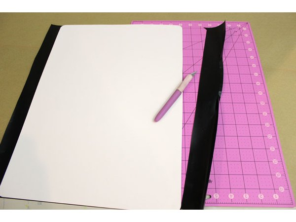 Trim the excess contact paper