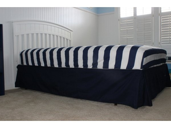 Be careful not to move the bed-skirt when setting the mattress down.