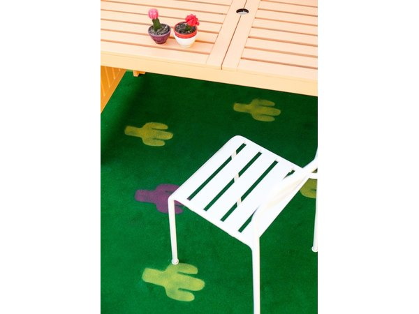 Roll an outdoor rug onto your patio for total comfortability.