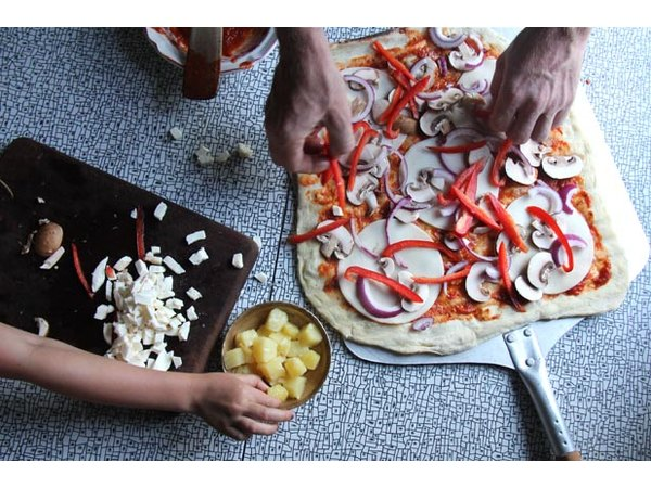 Children love making pizza and adding their own toppings.
