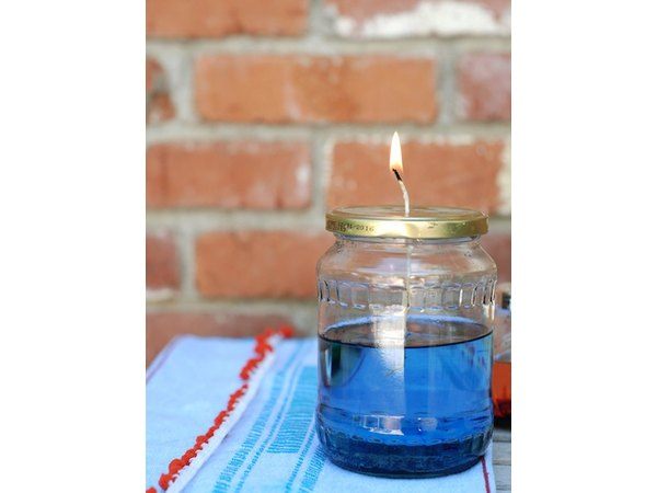 Illuminate your outdoor table with these oil lamp candles.