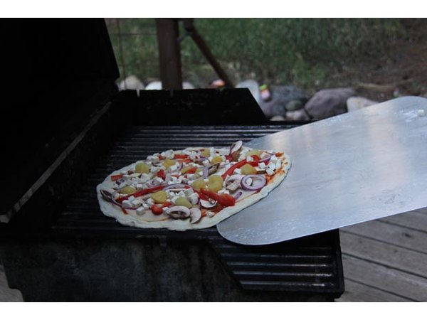 Place pizza back on the grill.