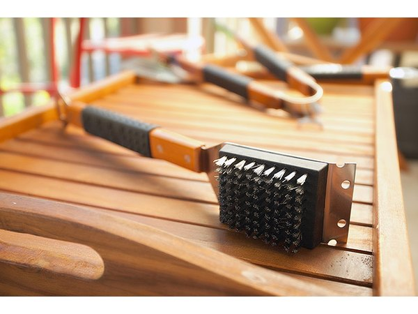 Don't cook over a dirty grill. Clean grates with a good brush.