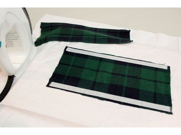 Hem the flannel pieces with fusible web