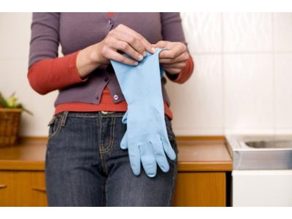 woman holding rubber gloves