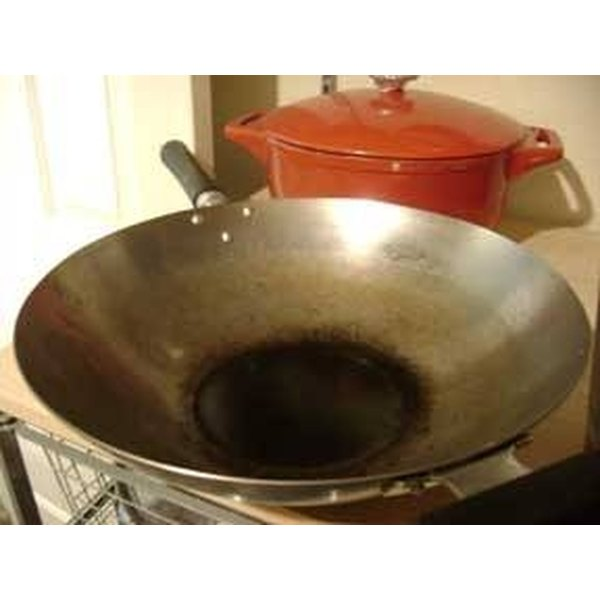 Seasoned woks will start to blacken---that means they're becoming more non-stick