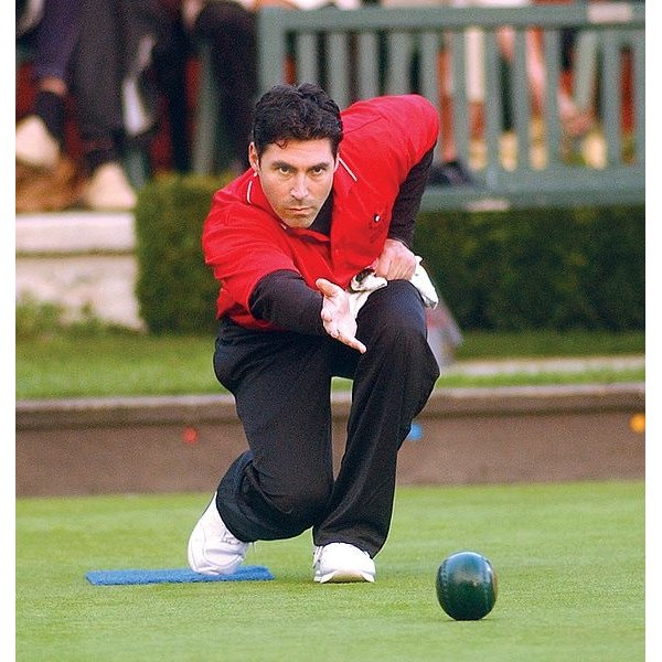 Lawn Bowler Tim Mason Shows Proper Balance on His Delivery.