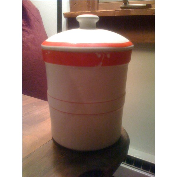 A ceramic container with a loosely fitted lid is perfect for storing your starter.