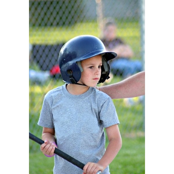 A batting helmet protects the batter's head from wild pitches.