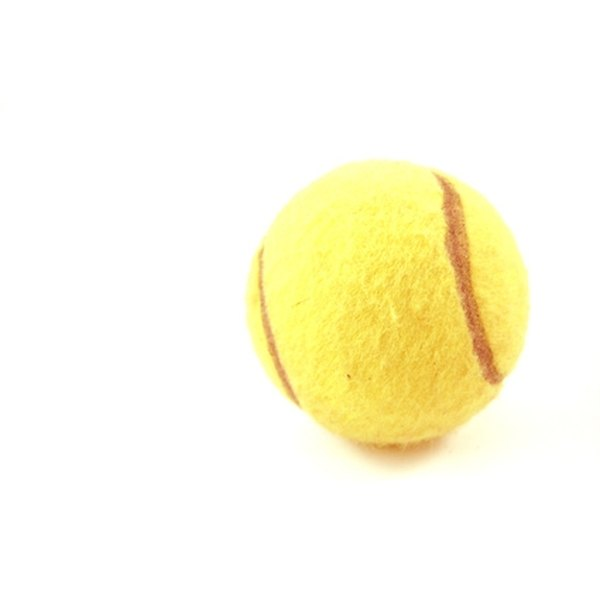Use a very sharp scalpel or knife to slice tennis balls.