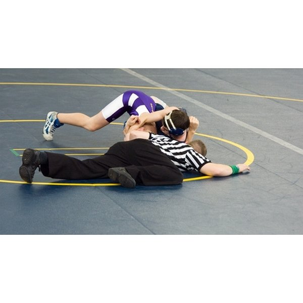 Wrestlers wearing singlets during a match to prevent being grabbed by their clothing.