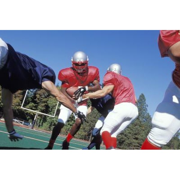 Football players build their skills with individual and group exercises.