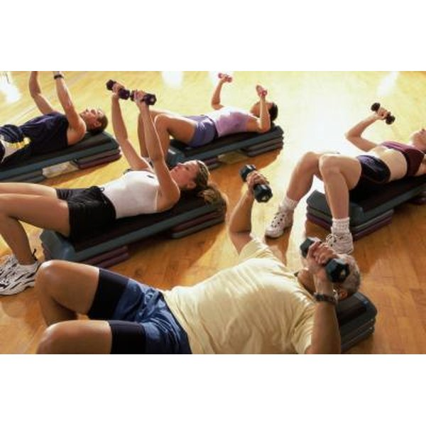 Group exercise class using free weights.