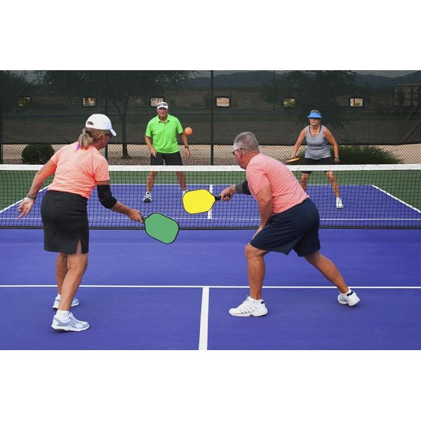People are playing the game of pickleball.