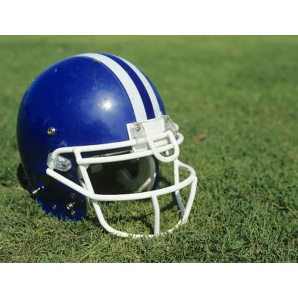 Close-up of football helmet on field.