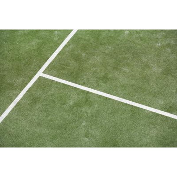Synthetic grass tennis courts offer easy upkeep and all-weather play.