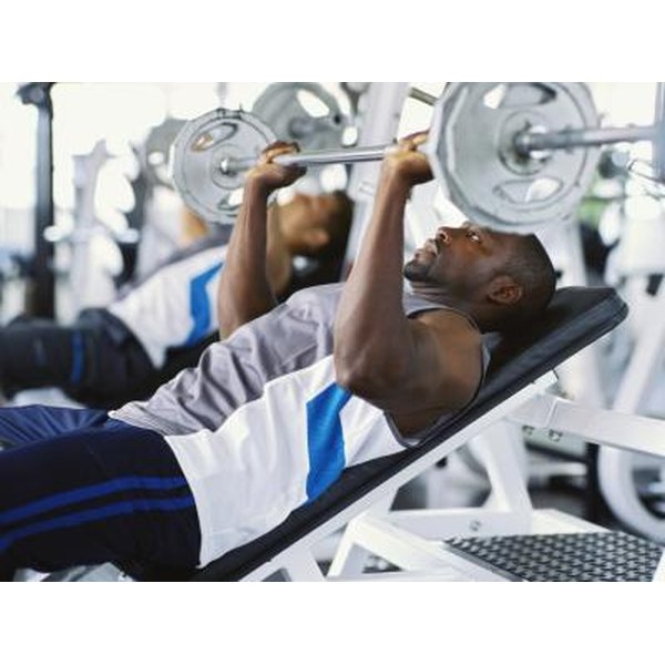 Weightlifting damages muscle cells, leading to elevated levels of enzymes such as AST.