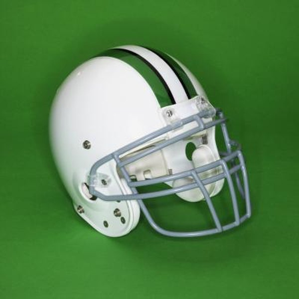 Use a scrub brush to easily remove scratches from your football helmet.