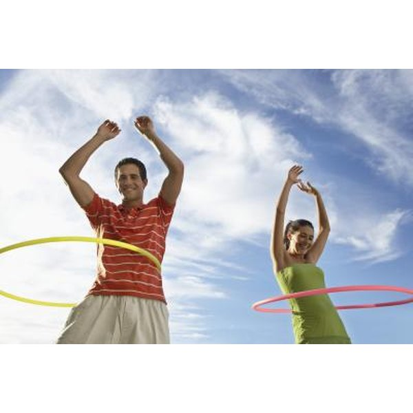two friends hula hooping