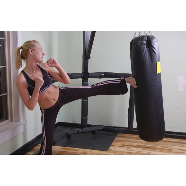 Woman practicing kickboxing.