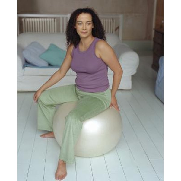 An exercise ball can help stretch your hips.