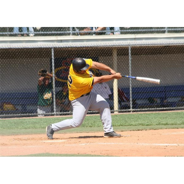 Baseball player hitting a ball during a game.