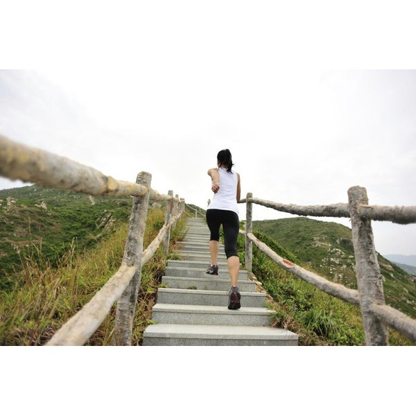 A Woman Jogging Up Flight Of Stairs In Natural Outdoor Setting