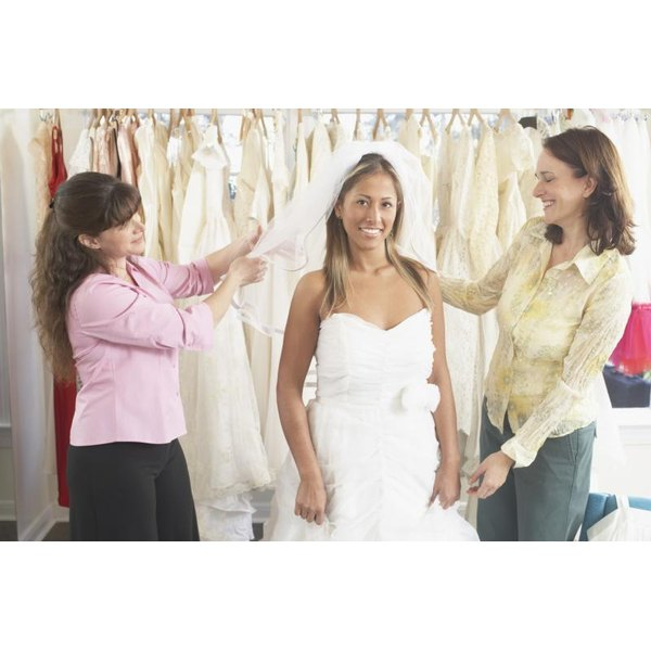 A Happy Bride To Be Is Getting Her Wedding Dress Fitted
